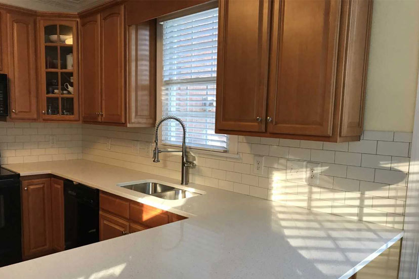 Quartz countertop with subway tile backsplash